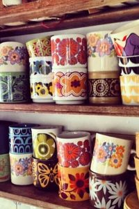 Rustic shelves with vintage mugs